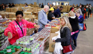 Volunteer from American Airlines,Patricia Driver, left, hands out food during a free food distribution for federal employees by the Regional Food Bank of Oklahoma at State Fair Park Monday, January 21, 2019.  Photo by Doug Hoke, The Oklahoman